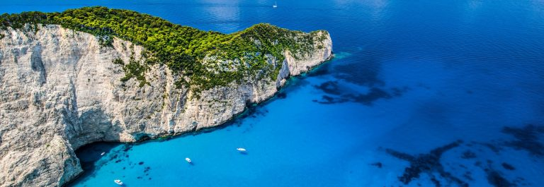 Boats-in-the-deep-blue-sea-Zakynthos-iStock-639405124-2