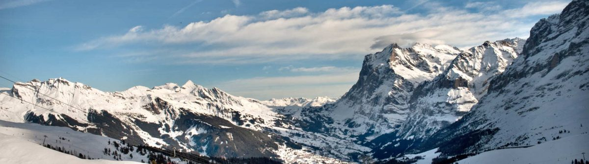 View-to-the-Grindelwald-valley-and-ski-tracks-of-Grindelwald-ski-resort_shutterstock_1193597851